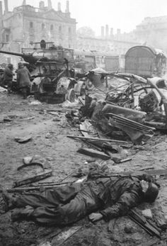 Battle of Berlin: German KIA in the foreground with Soviet tank T-34-85 of 55th Guards Tank Brigade away from the camera, April 1945. The Germans put up vicious resistance until the very last day of the battle.