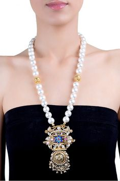 Amrapali: A gold plated pendant embellished with pearls, zircons and enamel in floral pattern.