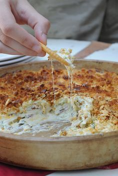 Jalapeño Popper Dip ~ everyone will ask for your recipe! Modifications: 2 8-oz packages of cream cheese, soft  1 cup of mayonnaise  4-6 jalapenos, chopped and deseeded.  1 cup of cheddar cheese, shredded  1/2 cup of mozzarella cheese, shredded  1/4 cup diced green onion   Topping:   1 cup of crushed crackers ( I used Ritz)  1/2 cup parmesan cheese  1/2 stick of butter, melted
