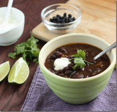 Crock pot Chipotle Lime Black Bean Soup. Garnish with chopped, tomato, avocado & sour cream