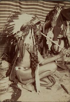 Old Coyote inside a lodge on the Crow Reservation in Montana - Crow - 1898