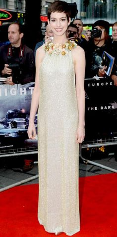 Look of the Day › July 19, 2012 WHAT SHE WORE For the London premiere of The Dark Knight Rises, Anne Hathaway accented her beaded Gucci gown with a bangle and diamond studs from Tiffany & Co., a metallic Jill Milan clutch and satin Casadei pumps. WHY WE LOVE IT The actress's sleek pixie and minimal accessorizing let her intricately embellished gown shine!