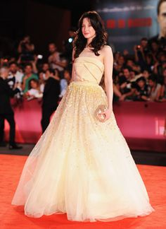 Andrea Riseborough stuns in a Christian Dior Couture creation - tulle skirt and satin bodice in lemon yellow at the Venice premiere of 'W.E'