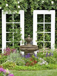 Make a Stage If you've got a focal point, such as this fountain, make sure to create a stage for it. These old window frames help focus attention on the fountain.
