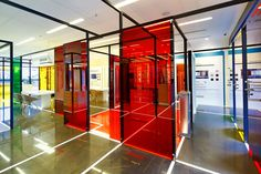 the design space demonstrates the integrated security services provided by the company by highlighting the brand's innovations with a vibrantly colored, paned glass installation.