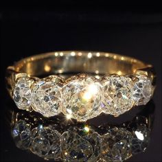 This Victorian Band Style five stone diamond 18k rose gold ring, made c. 1870. The diamonds are Old European mine cuts, total carat weight 2.09 carats