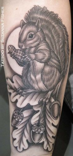 """Squirrel with a peanut Tattoo by Suzanna Fisher, Damask Tattoo, Seattle Washington."""