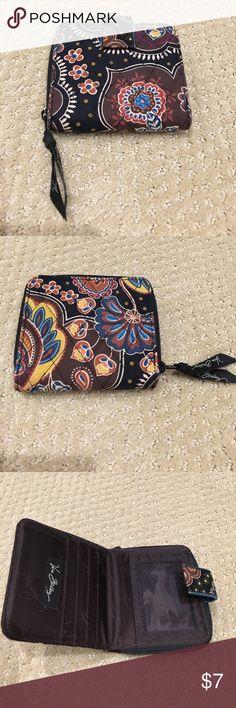 Vera Bradley Wallet Excellent condition Vera Bradley wallet. Brown and. Lack floral pattern Vera Bradley Bags Wallets