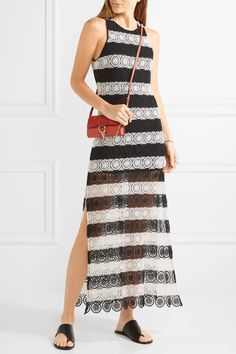 Alice + Olivia's striped 'Lucia' dress is crocheted with a pretty floral pattern. Perfect for warm weather getaways, this monochrome design is partially lined for coverage and has large side slits. It falls to a maxi hem and looks best with flat sandals. - Black and white crocheted polyester-blend - Concealed hook and zip fastening at back - 55% polyester, 45% cotton; lining: 94% polyester, 6% elastane - Dry clean