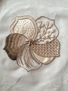 Lovely embroidery. Very creative use of sectioning, like a modern sampler. Different stitch for each petal.