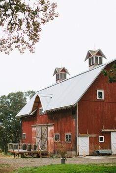 Barn...I love the cupolas.  Our barn had interesting lightning rods along the roof peak.