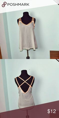 Adorable Orange Crisscross Strap Blouse In excellent condition! Extremely cute and comfortable! Buy 3 items, get one free plus 15 percent off your purchase total! Tops Blouses