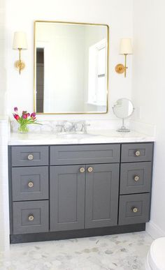 Traditional bathroom featuring gray shaker style cabinetry, marble hexagon… is part of Shaker Bathroom cabinet - Traditional bathroom featuring gray shaker style cabinetry, marble hexagon… Source by Small Grey Bathrooms, Grey Bathrooms Designs, Grey Bathroom Tiles, Gray Bathroom Decor, Bathroom Styling, Beautiful Bathrooms, Bathroom Flooring, Bathroom Lighting, Bathroom Ideas