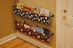 sling bookcase for kids--We did this in Reaves' room but it fell down so make sure they are in the wall really, really well! It is really cute and looks nice.