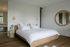 Wooden simple Bed. Open plan living. Mark Tuckey