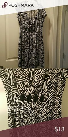 Zebra Print Short Sleeve Dress This dress works well with a blazer or cardigan over it. 191 Unlimited Dresses Midi