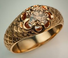 Antique Fancy Color Old European Cut Diamond Gold Men's Ring. The 14K gold ring has a finely detailed scale pattern on the shoulders and is prong-set with a fancy golden-brown 1.88 ct old European cut diamond. Circa 1910