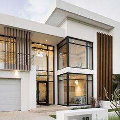 This stunning contemporary two-storey home has been shaped to fit the contours of a sloping block, harness ocean views, create a north-facing backyard sanctuary for year-round enjoyment and deliver well-zoned accommodation for a family of five. Modern Exterior House Designs, Modern House Facades, Dream House Exterior, Modern Architecture House, Modern House Plans, Modern House Design, Exterior Design, Architecture Design, Modern Home Exteriors