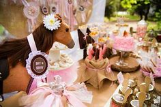 Check out this splendid pony party with burlap/felt birthday banner, flowers in spray-painted tin cans, printables, vintage horse ribbons & more.