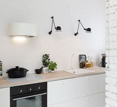 Kitchen Interior Design Remodeling Boooox Heritage Barn by Oooox - Awesome wooden retreat designed by Radka Valova of Oooox situated in the Czech republic. Kitchen Dinning, New Kitchen, Kitchen Decor, Kitchen White, Kitchen Brick, Kitchen Styling, Barn Kitchen, Kitchen Lamps, Dining Room