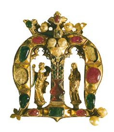The Founder's Jewel, in the form of a crown letter M and composed of gold, emeralds, rubies, pearls, and enamel, c. 1400; in the collection of New College, Oxford. By permission of the Warden and Fellows, New College, Oxford; photograph Thomas-Photos, Oxford