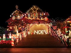 "HGTV- Covered in Lights  A tunnel of lights greets guests walking up the driveway of this decked-out home. An oversize ""NOEL"" sign and lighted candy canes enhance the larger-than-life design."