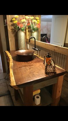 A beautiful walnut slab used as a bathroom counter. The live edge really brings that rustic character we know you're craving.