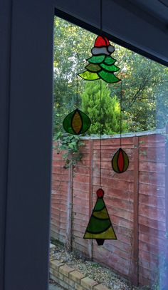 A beautiful handmade stained glass suncatcher with a bronze chain. The colorful joyful design is eye-catching. Consists of four different pieces of ornaments. Hang it near any window in your house and let the sunlight works its magic. The reflections of colors on surrounding walls will be