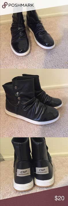 """Women's Black Athletic Style Boots size 8 Athletic sole, black leather boots with patent leather toe and button detail. These were a gift to my mom on my trip to Asia but didn't fit. There is a tag on each heel that reads """"CNP defend our nanhai"""" which a brand over there. Never been worn. They run a true size 8, even though it says 41 they run very small. Shoes Ankle Boots & Booties"""