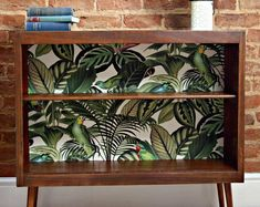 Upcycled Mid Century Bookcase with Tropical / Botanical Print and Custom Nightwatch . Upcycled Mid Century Bookcase with Tropical / Botanical Print and Custom Nightwatch … Funky Furniture, Redo Furniture, Mid Century Bookcase, Vintage House, Furniture Makeover Diy, Diy Home Decor, Diy Furniture Projects, Upcycle Bookcase, Upcycled Home Decor