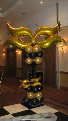 https://www.google.com/search?q=MASquerade balloon decor