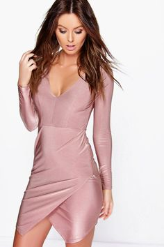 Get dance floor-ready in an entrance-making evening dress.   Look knock-out on nights out in figure-skimming bodycon fits, flowing maxi lengths and stunning sequin-embellished occasion dresses. This season make for satin sheen slip dresses in mink nudes, and match lace trim cami dresses with barely-there heels for that cocktail-ready combo. If glitterball gowns aren't your thing, take to the dance floor in a tux dress for an all-eyes-on-you androgynous look.