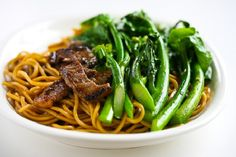 CHINESE BROCCOLI BEEF NOODLE STIR FRY ==INGREDIENTS== 3T soy sauce, 3T oyster sauce, 3T Shaoxing wine, sake or dry white wine, 1T sugar, 1T tapioca starch or cornstarch, 1t dark sesame oil, 1lb beef sirloin, 1lb fresh or 10ozs dried noodles, 2T vegetable oil, 3 large garlic cloves, 1.25c chicken/vegetable stock, 1lb Chinese broccoli or regular common broccoli, Freshly ground black pepper  ==================