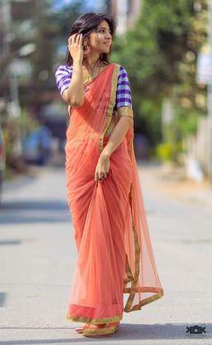 Unconventional pairing - a coral chiffon sari with a purple plaid silk blouse. Indian Beauty Saree, Indian Sarees, Indian Dresses, Indian Outfits, Lehenga, Anarkali, Saree Poses, Plain Saree, Simple Sarees