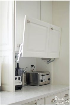 Hide Kitchen Electronics in a Flip-up Cabinet