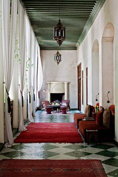Love the red rug (not surprised) and the green and white tiles (surprised)