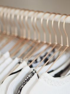 Love the idea of thin clothes hangers (more room) spray painted for more impact. In fact dry cleaning ones are free! Copper Hangers, Chevron Friendship Bracelets, Laundry Rack, Dressing Area, Macrame Plant Hangers, Micro Macrame, Macrame Knots, Clothing Photography, Bedroom Decor