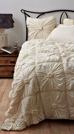 Like ruched bedding against wrought iron. Idea: paint wrought iron on wall?