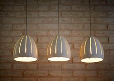 These pendant lights are hand made of white stoneware. They may be hung above your dining room table or in any other room.  You can choose