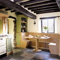 Lewis & Hill kitchen This informal, banquette seating area was purpose-built to fit the space in a period property.