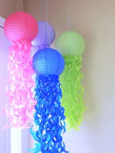 4 Jellyfish paper lanterns for your birthday parties or events. The lantern is 10 inches and the swirls (tentacles) are attached to the lantern