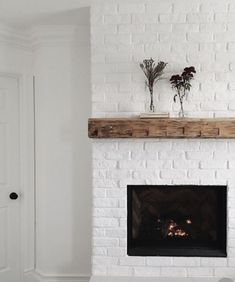We just installed an electric fireplace and added a brick surround. We painted the brick in Pure White from Sherwin Williams. Painted Brick Fireplaces, Paint Fireplace, Brick Fireplace Makeover, White Fireplace, Fireplace Remodel, Fireplace Design, Fireplace Ideas, Fireplace Brick, Fireplace Fronts