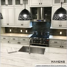 We love how clean this design looks ⚡ The combination of straight lines with subtle curves and the modern black and white color palette gives it a fresh, timeless aesthetic. The Legacy Undermount Sink in Luxe Stainless is the perfect sink choice for such a sleek kitchen. What is your favorite thing about this kitchen? FB HASHTAGS #whitekitchen #gasrange #kitchenisland #pendantlights #backsplashes #homeimprovement #hgtv Stainless Steel Farmhouse Sink, Undermount Stainless Steel Sink, Stainless Steel Cleaner, Stainless Steel Types, Undermount Sink, Stainless Kitchen, Timeless Kitchen, Luxury Interior Design, Home Kitchens