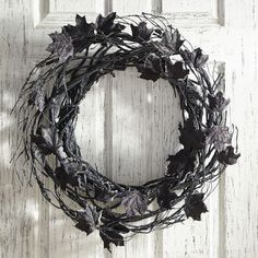 Maple leaves take on an unexpected hue in our glittery handcrafted wreath. Hang from walls and doors for a traditional statement, or lay it flat as part of a unique Halloween centerpiece.