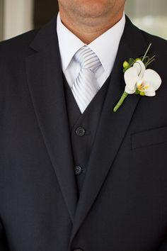 Simple orchid boutonniere for groomsmen (maybe teal tape on bottom to match with bridesmaid dresses?)