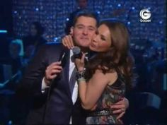 I love this Michael Bublé and Thalia version of Mis deseos/Feliz Navidad.