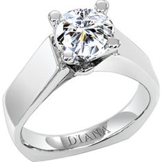 Diamond solitaire engagement ring with round center stone and bold wide flat band from Diana.
