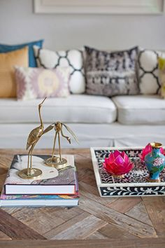 Design Manifest living room wood coffee table detail, inlaid tray, brass cranes