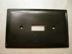 switch plates & outlet covers painted with Rustoleum's Oil Rubbed Bronze
