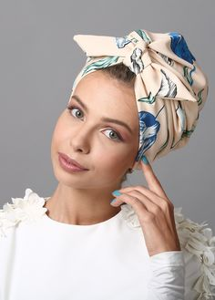 MATERIAL: spandex CARE: hand wash Knotted turban in turqouise floral print. Great for evening-wear or special events. The turban is stretchy, light, and easy to wear! No tying involved, this turban is worn like a hat. Can be worn as a full or half h